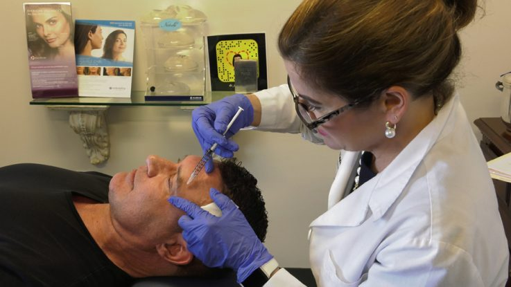 Dr. Anne Taylor gives a patient Botox injections in her Columbus, Ohio office. New statistics from the American Society of Plastic Surgeons reveals that minimally invasive procedures have risen more than 75% among men since 2000.